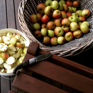 The cutting of the apples.